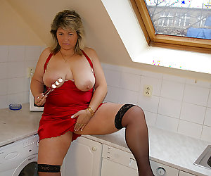 Big housewife playing in her kitchen