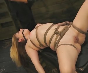 Blonde slut with small tits Lilly Ligotage bondaged and fucked hard by huge plastic dildo