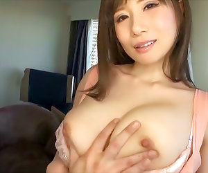 Sexy Japanese milf, Azumi Chino exposes big tits in a threesome