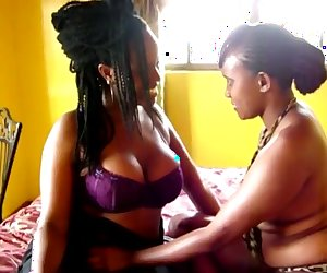 Gorgeous African babe seduced by lezzie