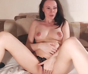 Sexy brunette throwing her pussy at a webcam