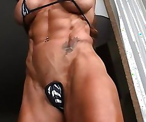 muscle women lindsay and lisa posing in micro bikini