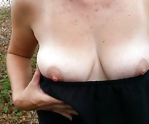 My girlfriend exposing her tits outside